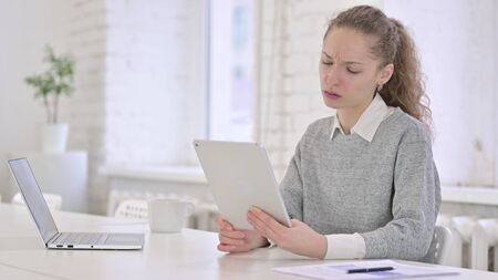 Unhappy Young Latin Woman reacting to Failure on Tablet Reklamní fotografie