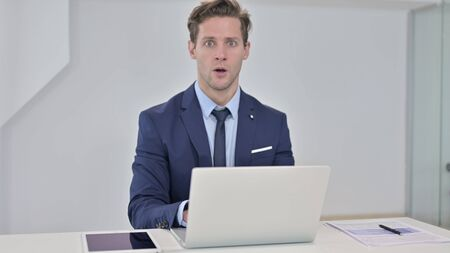 Disappointed Young Businessman in Shock Looking at Camera