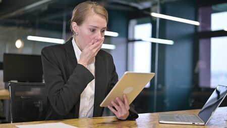 Disappointed Young Businesswoman Reacting to Loss on Tablet
