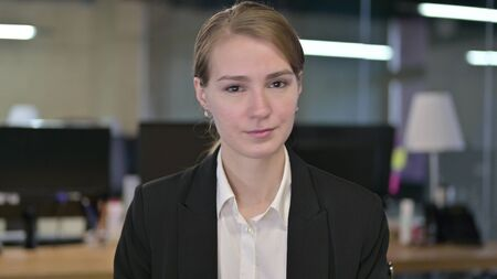 Portrait of Young Businesswoman saying No by Shaking Head Stock fotó