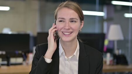 Portrait of Cheerful Young Businesswoman Talking on Smartphone Stock fotó