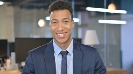 Portrait of Smiling Young Businessman Looking at Camera
