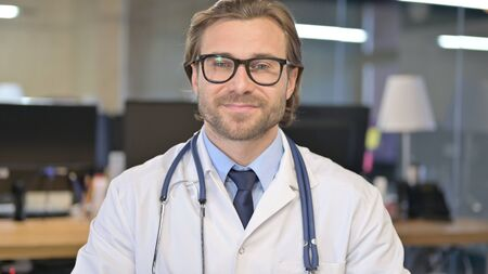 Portrait of Cheerful Doctor Smiling at Camera