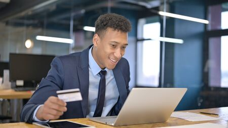 Young Businessman making Online Payment Success on Laptop