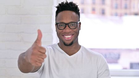 Portrait of Casual African Man doing Thumbs Up in Office