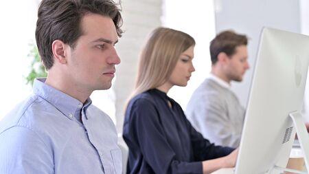 Startup Team using Desktop in Modern Office