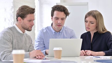Young Team Working on Laptop in Office