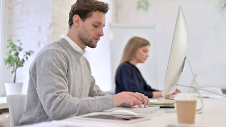 Professional Man Standing up and Going Away from Office