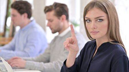 Portrait of Serious Creative Woman saying No with Finger Sign