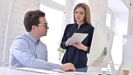 Creative Woman Discussing with Man using Desktop in Office Stock fotó