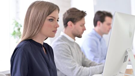 Young Creative Professionals Working in Office