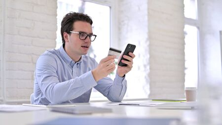 Shopping Online, Young Man Celebrating Online Payment on Smartphone