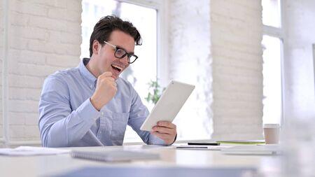 Ambitious Businessman Celebrating Success on Tablet