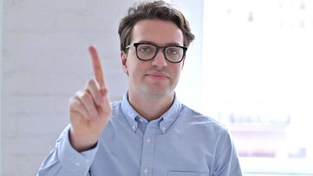 Portrait of Serious Young Businessman saying No with Finger Sign Stock fotó