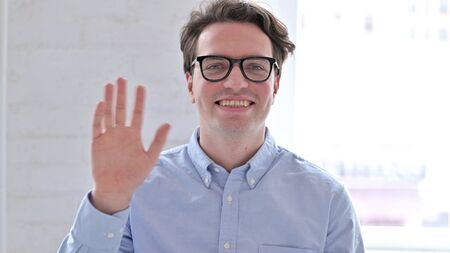 Portrait of Cheerful Young Man doing Video Chat Stock fotó