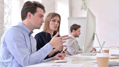 Startup Team Working on Desktop and Tablet Together