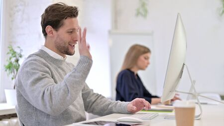 Cheerful Man doing Video Chat on Desktop