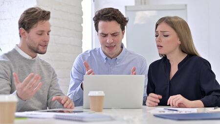 Creative Team Reacting to Failure on Laptop