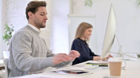 Man Coming and Sitting at Office Desk Stock fotó