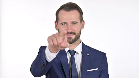 Portrait of Young Businessman Pointing Finger and Inviting, White Background Stock Photo
