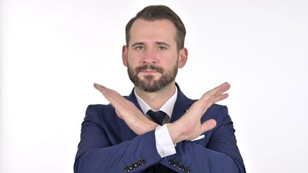 Portrait of Young Businessman saying No by Hand Gesture, White Background