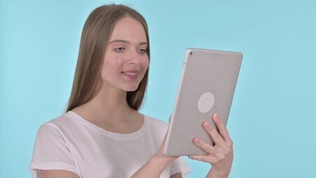 Young Woman using Tablet, Blue Background