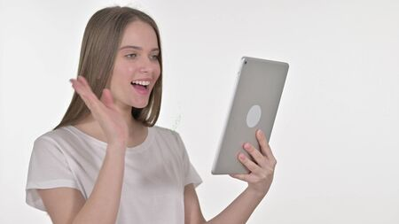Video Chat on Tablet by Young Woman, White Background