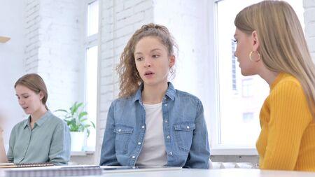 Upset Young Women having Argument in Office