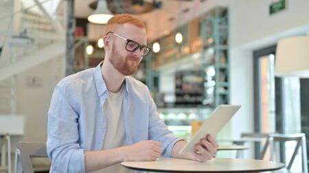 Redhead Man, Failure on Tablet in Cafe