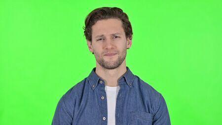 Sad Young Man Looking at the Camera on Green Chroma Key