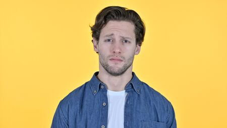 Worried Young Man on Yellow Background Archivio Fotografico
