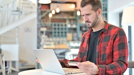 Unsuccessful Online Payment on Laptop by Beard Young Man