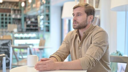 Pensive Young Man Thinking of creative Idea in Cafe Standard-Bild