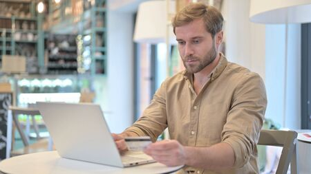 Online Payment, Shopping on Laptop by Young Man