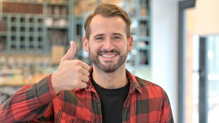 Portrait of Thumbs up by Approving Beard Young Man