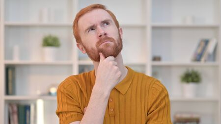 Portrait of Redhead Man Thinking and Getting Idea