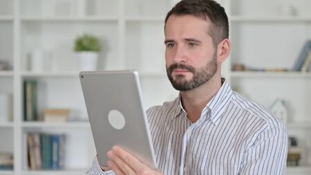 Portrait of Ambitious Young Man using Tablet