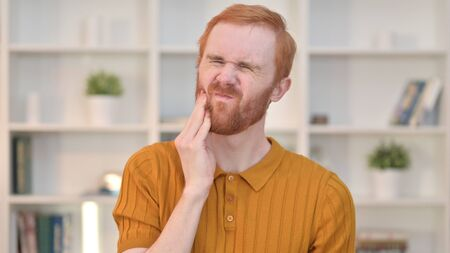 Portrait of Attractive Redhead Man having Toothache