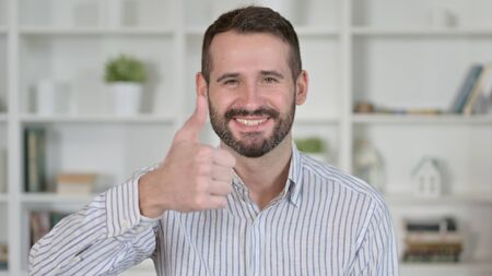 Portrait of Young Man showing Thumbs Up 免版税图像