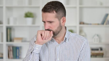 Portrait of Sick Young Man Coughing