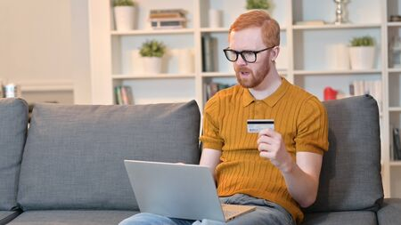 Unsuccessful Online Payment by Redhead Man on Laptop