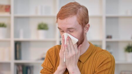 Portrait of Sick Redhead Man Sneezing
