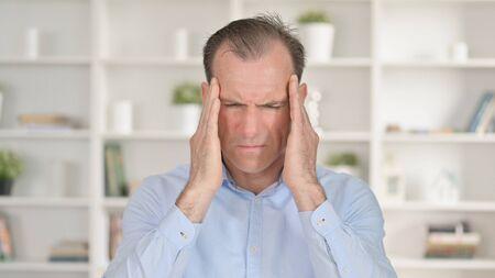 Portrait of Tired Middle Aged Businessman having Headache 免版税图像 - 148658304