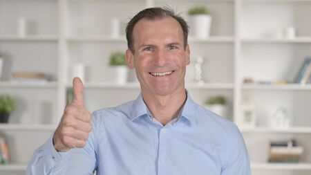 Portrait of Successful Middle Aged Businessman showing Thumbs Up