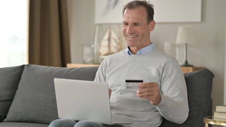 Attractive Businessman Successful at Online Payment on Smartphone
