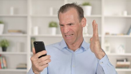 Middle Aged Man Getting Loss on Smartphone