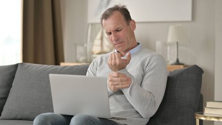 Hardworking Middle Aged Businessman having Wrist Pain