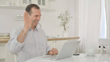 Middle Aged Man doing Video Call on Laptop at Home