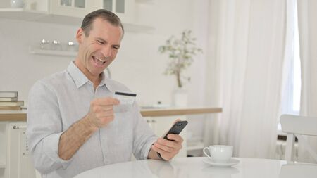 Online Payment Failure by Middle Aged Man on Smartphone