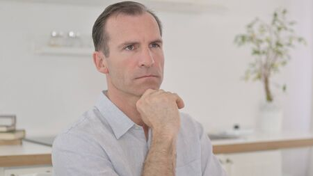 Portrait of Thoughtful Middle Aged Man Thinking